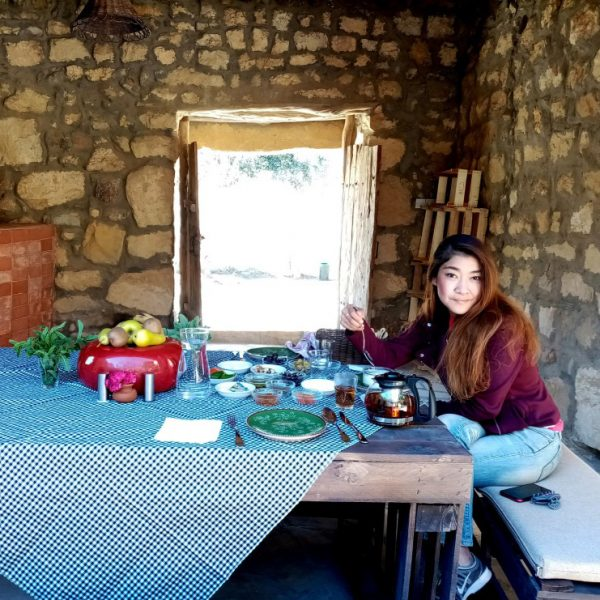 Breakfast in the courtyard ot the Guesthouse with the door to the garned