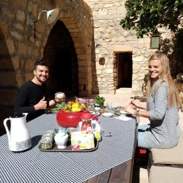Guest enjoying their breakfast in the courtyard of Beit al Taybeh