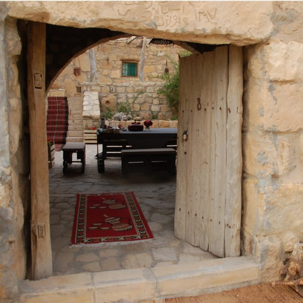 The old wooden door that gives acces to the courtyard of Beit al Taybeh